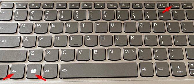 Teclado de computadora con teclas Windows, Fn y PrtScr identificadas con flechas