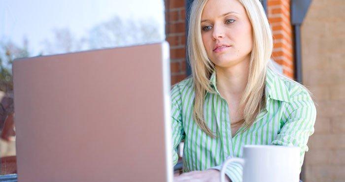 Woman Laptop Coffee Shop Shutterstock 700px